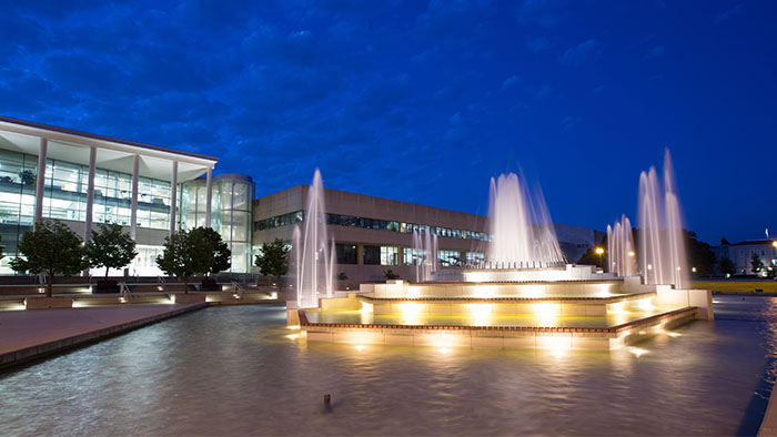 Night view of the fountain outside Meyer Library