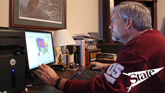 Missouri State Online student working from laptop at home.